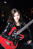Brunettte guitar player girl — Stock Photo