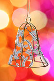 Christmas bell against blurred background — Stock Photo