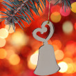 Christmas bell against blurred background — Stock Photo #4296275