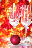 Two empty glasses and red ball decoration — Stock Photo