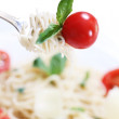 Spaghetti, basil and tomato on fork — Stock Photo