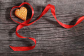 One cookies and heart shaped red ribbon — Zdjęcie stockowe