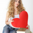 Foto Stock: Blond girl with big valentine card