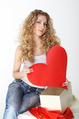 Blond girl with big valentine card — Stock Photo
