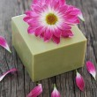 Bar of natural green soap with flower - Stock Photo