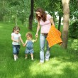 Happy family on picnic in summer park - Stockfoto