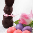 Stock Photo: Easter eggs with tulip and chocolate hare
