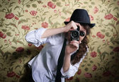 Young girl with vintage camera — Stock Photo