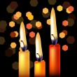 Three festive candles — Stockvektor