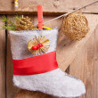 Christmas stocking hanging on wooden background — Foto de Stock