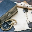 Stock Photo: Old bible and compass