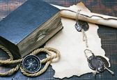 Old bible and a compass — Stock Photo