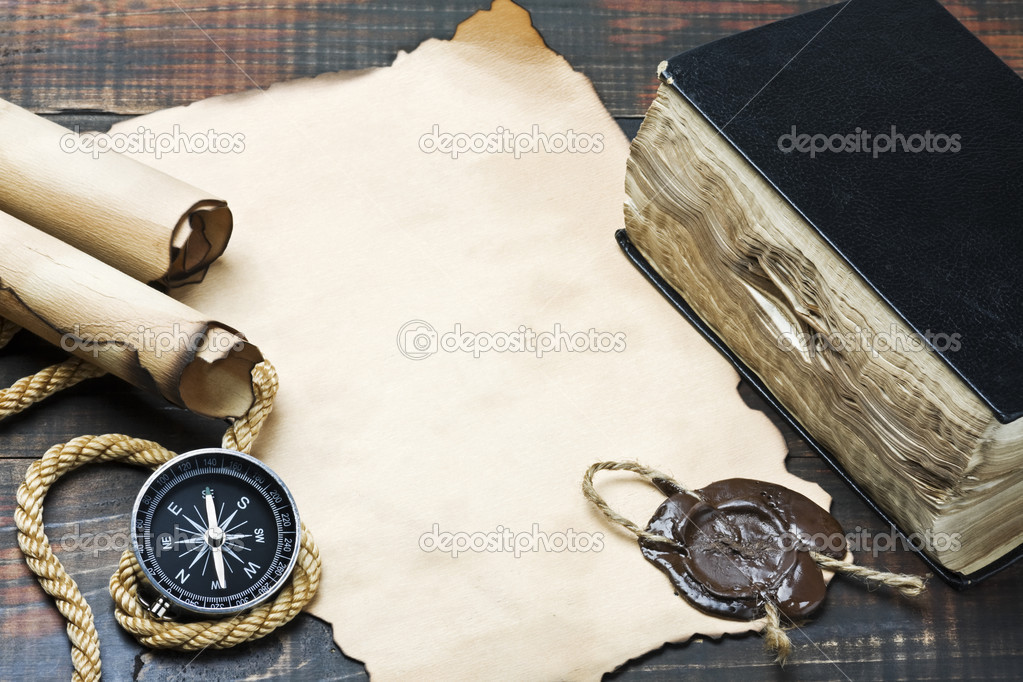 The Bible and compass on old paper — Stock Photo #4775639