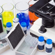 Microscope and biological reagents - Stock Photo
