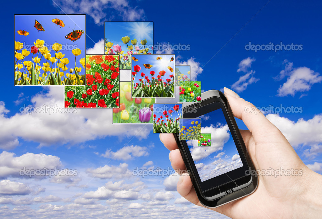 Touch screen mobile phone with streaming images  — Stock Photo #5154093