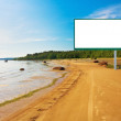 Billboard on the beach - Stock Photo
