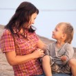 The mother and the son have a rest on seacoast — Stock Photo