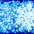 Snowflake on an abstract blue background — Stock Photo