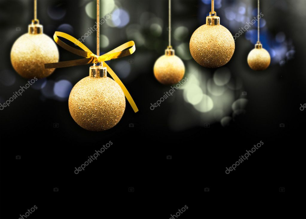 Gold Christmas balls on a multi coloured sparkling background — Stock Photo #4357017