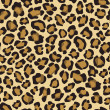 Stock Vector: Seamless background with leopard skin pattern