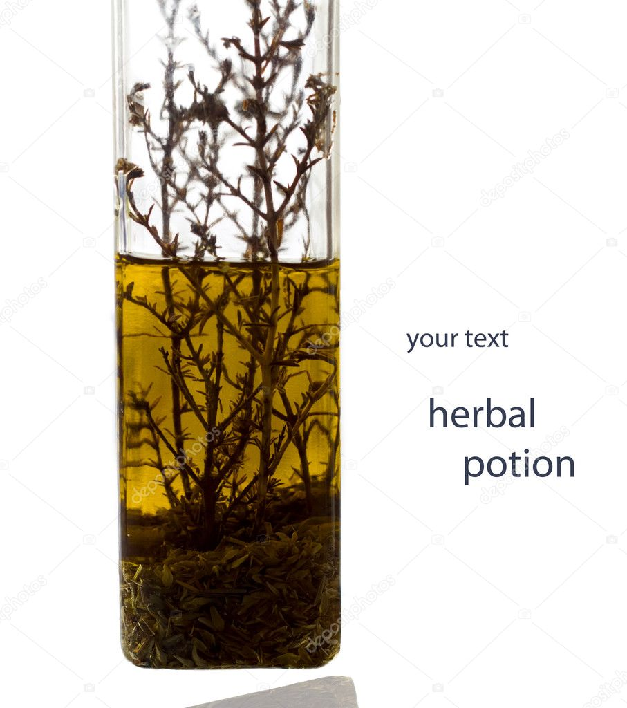 Grassy infusion in a transparent bottle . — Stock Photo #4910201
