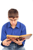 Teenager with old book — Stock Photo