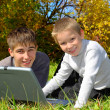 Teenager and kid with notebook — Stock Photo
