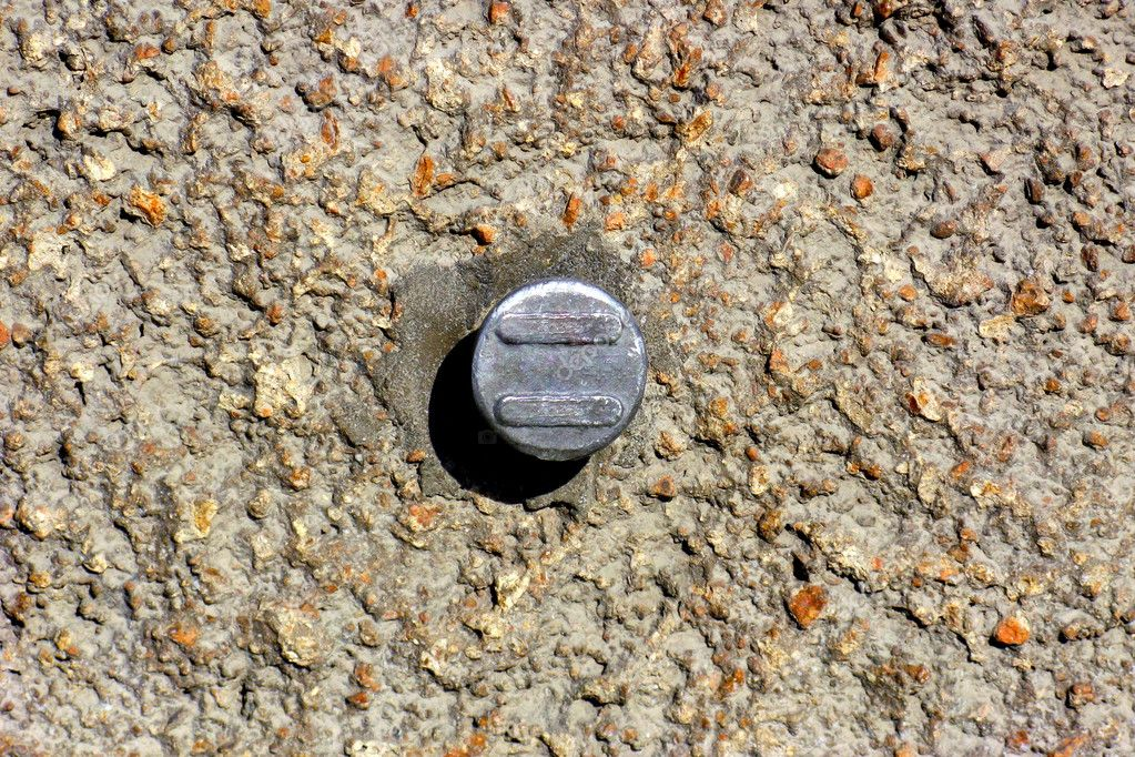 Concrete wall with round metal object in the centre  Foto Stock #5171389