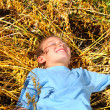 Boy in wheat field - Stock Photo