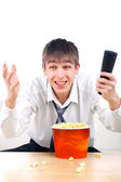Teenager with remote control — Stock Photo