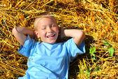 Boy in wheat field — Stock Photo