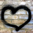 Heart on brick wall — Stock Photo