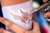 Air brush tatoo — Stock Photo