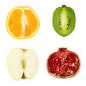 Four halved fruit — 图库照片