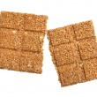 Sesame seed bar broken in half — Stock Photo