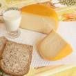 Cheese, glass of milk and bread — Stock Photo