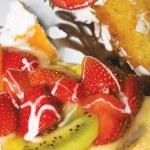 Sweet dessert with strawberry, kiwi and melon — Stock Photo