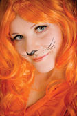 A young woman played by a tiger — Stock Photo