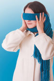 Conceptual picture. A girl tries to hide from the outside world, — Stock Photo
