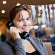 The girl speaks by phone at the airport — Stock Photo