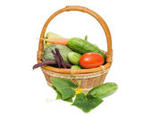 Wattled basket with vegetables isolated on white — Stockfoto