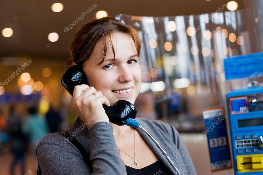 The girl speaks by phone at the airport — Stock Photo #3949202