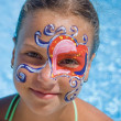 Girl with paint on his face in the pool — Stock Photo
