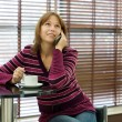 Stock Photo: Girl talks by mobile phone