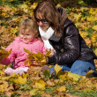 Mum with a daughter in autumn park — Stock Photo #4021838