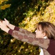 The beautiful girl with autumn leaves — Stock Photo