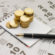 Stock Photo: Sheets of calendar with coins and notebook