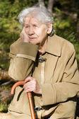 Beautiful portrait of an elder woman outdoors — Stock Photo