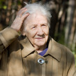 Beautiful portrait of an elder woman outdoors - Stock Photo