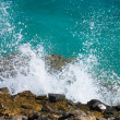Waves break about stones - Stock Photo